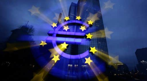 File zoom-burst image shows the illuminated euro sign in front of the headquarters of the European Central Bank in Frankfurt